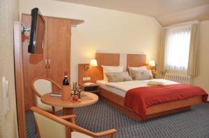 Ein Bett oder Betten in einem Zimmer der Unterkunft Berghotel Simon