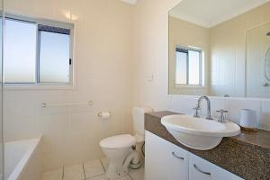 A bathroom at Harmony Apartment