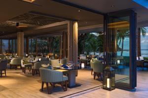 A restaurant or other place to eat at Phuket Marriott Resort and Spa, Nai Yang Beach
