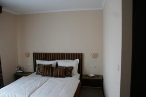 Krevet ili kreveti u jedinici u objektu Guest Accommodation Atrium Gulin