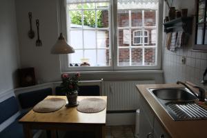 Küche/Küchenzeile in der Unterkunft Ferienwohnung Am Mittelburgwall