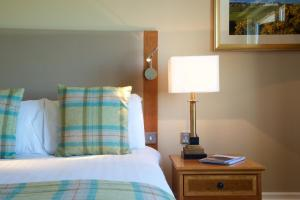 A bed or beds in a room at Carnoustie Golf Hotel 'A Bespoke Hotel'
