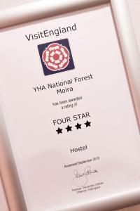 A certificate, award, sign, or other document on display at YHA National Forest