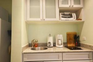 A kitchen or kitchenette at Solarium at Coronado Bay