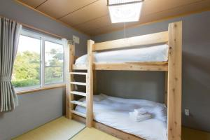A bunk bed or bunk beds in a room at Swing Bridge House