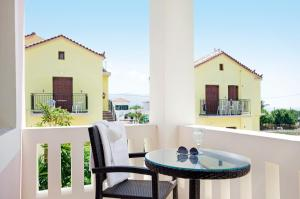 A porch or other outdoor area at Aphrodite Hotel & Suites