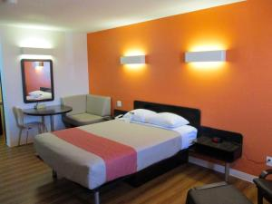 A bed or beds in a room at Motel 6-Innisfail, AB