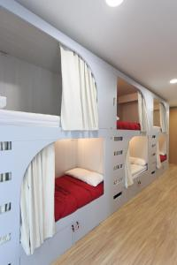 A bed or beds in a room at Albergue de Pamplona-Iruñako