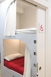A bunk bed or bunk beds in a room at Albergue de Pamplona-Iruñako