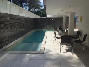 The swimming pool at or near Apartamento Capitães de Areia