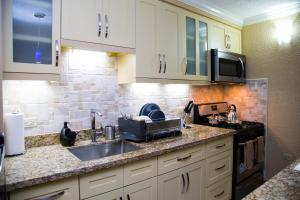 A kitchen or kitchenette at Choose To Be Happy at Long Mountain Cabin - One Bedroom Apartment