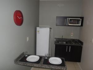 A kitchen or kitchenette at Le Petit Flat