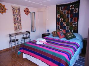 Cama ou camas em um quarto em Hostal Campo Base
