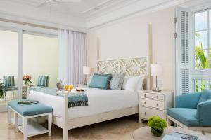 A bed or beds in a room at The Shore Club Turks & Caicos