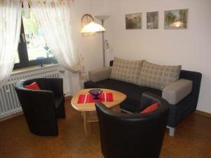 Ein Sitzbereich in der Unterkunft Ferienwohnung Panoramablick