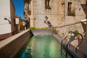 The swimming pool at or near Hotel del Sitjar