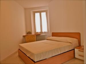 A bed or beds in a room at Locanda Posta
