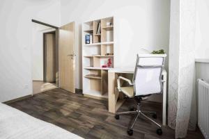 TV a/nebo společenská místnost v ubytování Kampus Palace