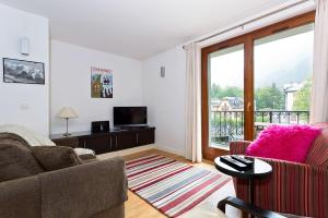 A seating area at APARTMENT COSMIQUES - Central Chamonix - Sleeps 4