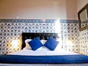 Uma cama ou camas num quarto em Coimbra Portagem Hostel