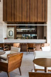 A restaurant or other place to eat at Vogue Square Fashion Hotel by Lenny Niemeyer