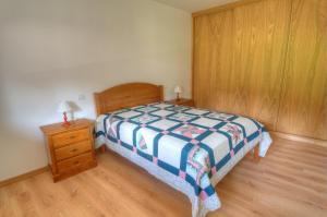 Uma cama ou camas num quarto em Casa das Gêmeas