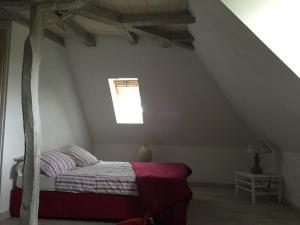 Un ou plusieurs lits dans un hébergement de l'établissement Château de Taussac