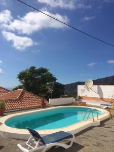Het zwembad bij of vlak bij Casa Óscar