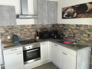 Küche/Küchenzeile in der Unterkunft Ferienhaus Brueckner