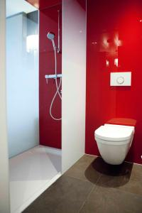 Ein Badezimmer in der Unterkunft Agora Swiss Night by Fassbind