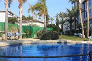 The swimming pool at or near Hotel Rober Palas