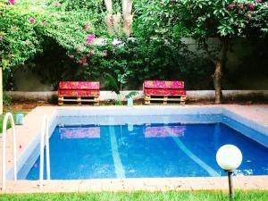 The swimming pool at or near Umoja Guesthouse II