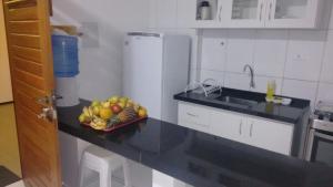 A kitchen or kitchenette at Estúdio Ibiza II