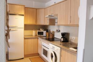 Una cocina o zona de cocina en Casa Al mar