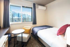 Um quarto em HOTEL MYSTAYS Kanda