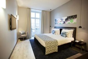 A bed or beds in a room at Internacional Design Hotel