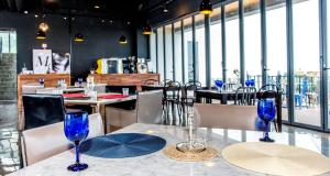 A restaurant or other place to eat at Lucid M