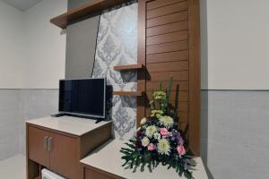 TV a/nebo společenská místnost v ubytování Le Lima
