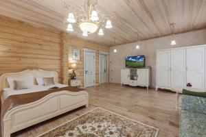 A television and/or entertainment centre at Altay Resort