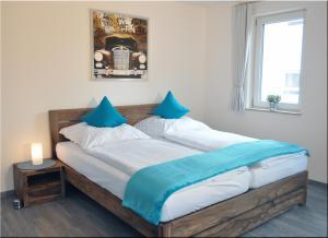 Ein Bett oder Betten in einem Zimmer der Unterkunft Moserhof-Apartments