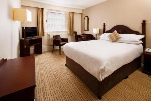 A bed or beds in a room at Mercure Perth Hotel