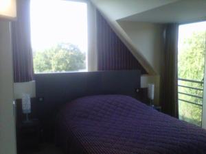 Un ou plusieurs lits dans un hébergement de l'établissement Domaine De Kermodest