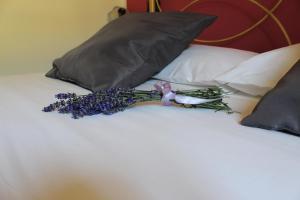 Letto o letti in una camera di Masseria Monte Pizzi