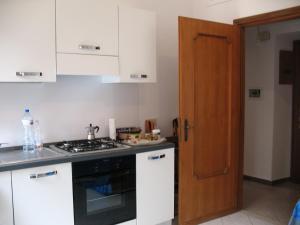 Cucina o angolo cottura di All In Rome Apartment