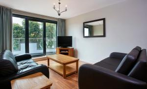 The lounge or bar area at Cordia Serviced Apartments