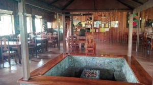 The lounge or bar area at Native Village Inn