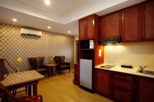 A kitchen or kitchenette at Nova Park Hotel