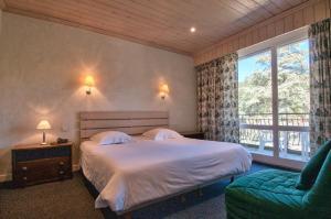Un ou plusieurs lits dans un hébergement de l'établissement Hotel du Lac