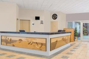 The lobby or reception area at Super 8 by Wyndham Portage La Prairie MB