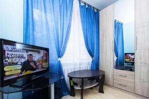 Телевизор и/или развлекательный центр в ApartLux апартаменты рядом с Москва-Сити